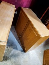 Two kitchen cabinets with doors and shelves in Bolingbrook, Illinois