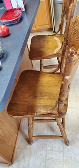 Two used wooden bar stools in Bolingbrook, Illinois
