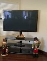 TV mounted on an iron and glass stand in Camp Pendleton, California