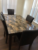 Dining Table with leather seats in Camp Lejeune, North Carolina