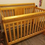 Solid wood crib with full size mattress conversion in Spring, Texas