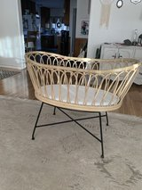 Crate and barrel rattan bassinet in Vista, California
