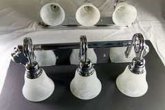 Pair of 3 light vanity bars with newer shades in Oswego, Illinois