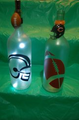Large lighted football themed bottles in Naperville, Illinois