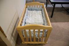 Lockable Wooden Baby Crib + Mattress + Embroidered Cover + Sheets in Westmont, Illinois