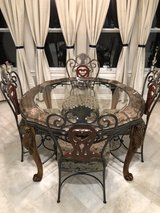 Ashley glass table and 4 chairs and bakers rack and 2 bar chairs in Spring, Texas