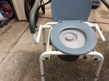 Bed side potty drop down arms in Kingwood, Texas