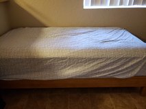 Twin bed with plateform bed frame and 2 sets of sheets in Camp Pendleton, California