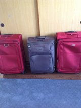 """Suitcases  Red ones are 29""""   Gray suitcase is 28"""" all spinners All in great shape in Okinawa, Japan"""
