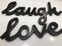 Laugh Love wall signs in Conroe, Texas