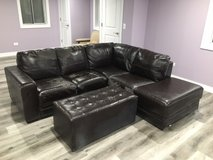 Leather couch sectional and ottoman in Chicago, Illinois