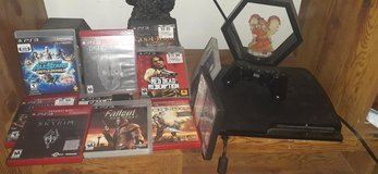 Ps3 with controller and games and downloaded games in Moody AFB, Georgia