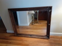 A large wood carved framed mirror in Alamogordo, New Mexico