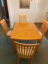 Solid wood dining table and 4 chairs in Alamogordo, New Mexico