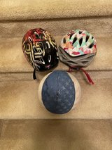 2 kids bike helmets and basketball in Fort Carson, Colorado