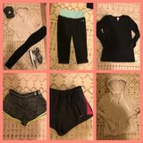 Woman's athletic clothes n shoes in Fort Carson, Colorado
