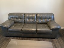 Gray leather couch in Nellis AFB, Nevada