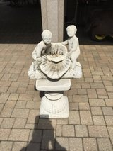 2 Concrete figures on base. Figures can be used as a fountain in Plainfield, Illinois