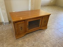 Oak and glass tv stand with pull out storage in Alamogordo, New Mexico