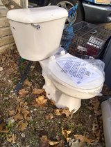 Bone colored toilet with insulated tank in Morris, Illinois