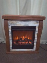 fire with brick and wood effect surround in Lakenheath, UK