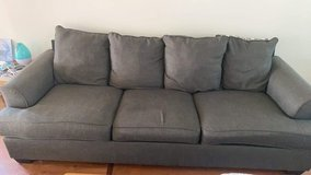 Grey couch and loveseat set in Charleston, South Carolina