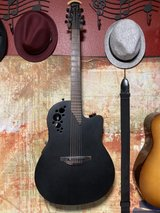 Ovation Elite TX1778 black matte acoustic/electric guitar with hard case in Alamogordo, New Mexico