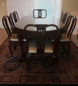 Rosewood Dining Table with 8 Chairs set in Camp Pendleton, California