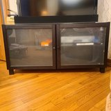 Brown TV stand/ entertainment center in Naperville, Illinois