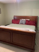 solid wood king bed frame with side rails and box springs in Fort Campbell, Kentucky