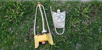Scrap metal or for repair heavy lawn sprinklers on curb in Naperville, Illinois