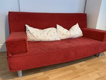 IKEA Sleeper sofa / Couch with red corduroy cover & pillows in Wiesbaden, GE