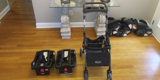 Graco click connect stroller and 2 car seat bases in Warner Robins, Georgia