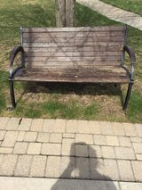 Large wood and heavy cast iron bench in Joliet, Illinois