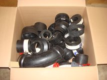 LOOK THRU A BOX OF FLEXIBLE RUBBER PIPING in Chicago, Illinois
