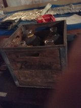 Bordens wood crate with 4 one gal jugs in Fort Polk, Louisiana