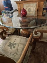 Round glass/wood dining office game room table in Quad Cities, Iowa