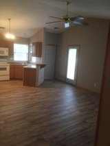 Brand new flooring, paint, blinds.  Includes washer/dryer, and garage in Fort Riley, Kansas