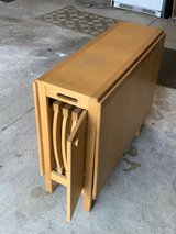 Folding wooden table with 4 folding chair storage in St. Charles, Illinois