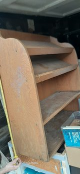 Wood bookcase on wheels in Fort Riley, Kansas
