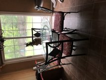 Glass table and four chairs in Jacksonville, Florida