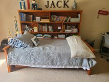 Twin bedroom with bookcase in Plainfield, Illinois