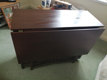 Dark brown dropside table with 4 chairs in Lakenheath, UK