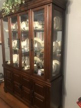 dining room table chairs hutch and lighted China cabinet in San Antonio, Texas