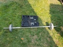 Weight bar with weight plates in Vacaville, California