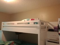 Twin Loft bunk bed with wooden stair case in Kissimmee, Florida
