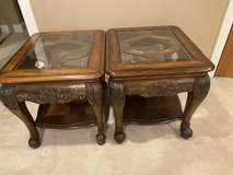 Carved wood glass top end tables in Aurora, Illinois
