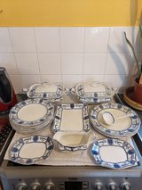 old large dinner service. some chips, crazing and discolouration from age and use. in Lakenheath, UK