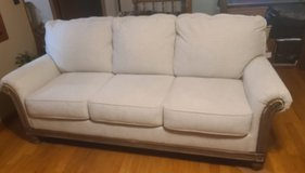 Ashley furniture couch off white barely used in Warner Robins, Georgia