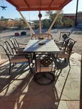 Patio table and chair set plus BBQ in 29 Palms, California